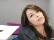 She opens her stocking covered legs and rubs her pussy under her desk, even getting a sex toy out and plunging it deep inside of her tight MILF pussy.