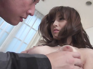 Babe pinches her Japanese tits while getting fucked.