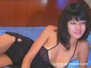 Sexy Asian webcam chick spreading her legs on cam. 2