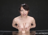Curious Japanese AV model Akane Yoshinaga with big juicy tits arranges hardcore titty fucking with a fancy sex toy.