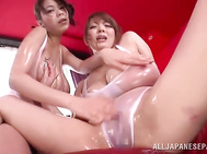 Peachy Japanese lesbian milfs Hitomi and Riai Sakuragi gets excited with each other, teasing and moisturizing their lovely big boobs, and they involve their amazed boyfriend into hardcore threesome fun, sharing his cock and taking it in their mouths, and