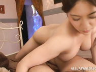 Busty Asian masseuse Meguri gets her oiled body banged doggie fashion.