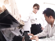 Naughty Asian milf piano teacher has huge boobs her student enjoys.