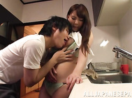 Busty Japanese housewife Yuka Kitsu fondles cock with her breasts.