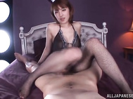 Stunning Japanese chick Tsubasa Amami wears sexy fishnet stockings and nice lingerie.