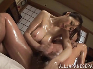 She gets her sexy body oiled and starts to please her sexy lover, massaging his body and making kinky footjob.
