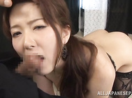She gets her tits squeezed and her shaved pussy rubbed with sex toys, and then engulfs the guy's rod, getting cumshot in mouth.
