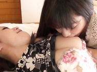 Pretty Asian milfs are spending time together in the bedroom.