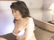 He is kissing her and fondling her white panties before taking them off to get to her hairy pussy.