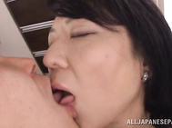 Horny mature lady Emiko Ejima enjoys sex with a young guy.