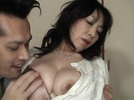 Hot mature Japanese AV Model in bondage gets tit fuck.