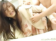 Sexy Japanese AV model screams in hardcore action.
