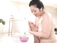 Fair Asian maiden Minako Komukai gives erotic naked massage and oils the guy´s body with rubbing her stunning boobs.