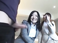 These two Asian ladies are co workers in the same office.