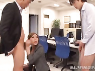 Rin Sakuragi is an Asian babe who goes to work just to get fucked! She is enjoying a threesome on the office and giving a double blowjob, slobbering on both boners before the pussy action starts! She is a hottie in black stockings and she is getting into