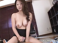 Amateur office babe, Satomi Suzuki, feels like playing nasty at work and pleasing this horny guy with a staggering handjob but not before teasing him well with her big natural tits and lusty skills in posing her nude forms.