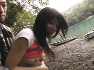 Pretty Asian doll Erika is waiting for her guy by the lake.