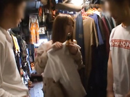 Horny Japanese babe in coat teasing two horny guys and gag them cocks.