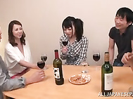 Dinner turns naughty for sleazy Japanese girls.