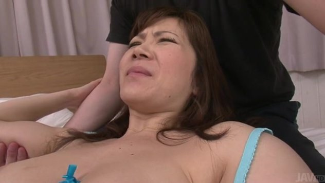 Sweet Japanese mature, Ichika Asagiri, shows off her nasty side by dealing two large cocks in a special Japanese gangbang.
