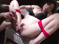 Voluptuous Japanese milf in heats, Mirei Yokoyama, is close to having her hairy Asian pussy fully demolished in a mind blowing bondage show by letting two males finger fuck and crack it with toys.