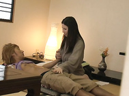 Hot Asian milf throats cock in a hotel room.