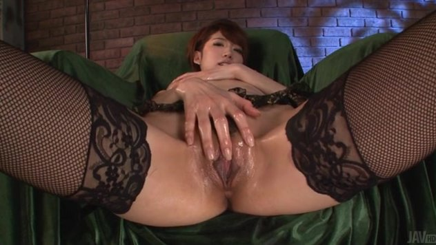 Naughty Japanese doll, Makoto Yuukia, is horny and more than willing to pose while cracking her wet pussy with her new toy.
