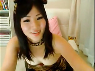 Cute Asian cam chick toying both holes. 2
