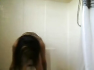 Tattooed Asian babe gets off in the shower. 3
