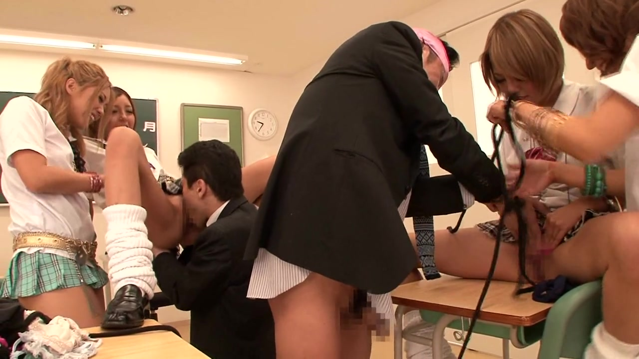 A group of students take a break from schoolwork to suck and fuck in the classroom.
