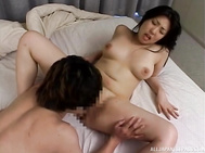 This mature Tokyo babe has a nice set of big tits that her younger guy enjoys when they are together.