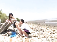 Ki Hanyuu is an Asian hottie enjoying the beach with her boyfriend.