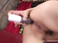 Beautiful Japanese milf An Koshi looks so hot in her black nylon stockings, and she likes to have hardcore fun getting her anal hole drilled.