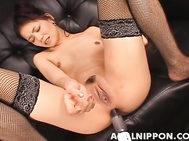 Luscious Japanese stunner in black panties and fishnet stockings Kaede lounges on a leather sofa and spreads her nice long legs wide apart to get pleasure of hardcore masturbation process.
