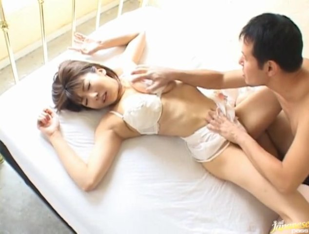 Busty MILF Yuuko Sakurai wore some sexy white lingerie that barely covered her big tits, and they're not covering anything for long, because he's pulling it off to get at her hot body.