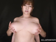 Gorgeous Asian MILF Ran Niiyama is standing motionless as her huge boobs get grabbed from behind and squeezed hard.