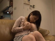 Sitting on the couch alone while naughty thoughts roll through her head, busty housewife Rin Aoki starts to touch herself lovingly.