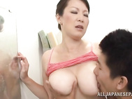Hot Japanese mature chick with huge knockers gets tit fuck.