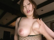 She is hot and her big tits show off nicelky in her fishnet lingerie.