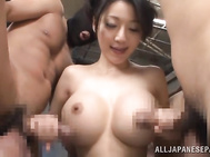 Experienced Japanese milf Miki Ichiki enjoys having outstanding sex with two active guys.