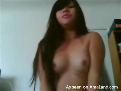 Cute Korean chick strips and lays with her pussy.