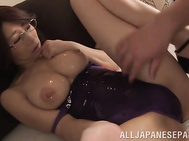 The horny mature chick wears a sexy tight swimsuit of a violet color, and she spreads her legs wide in order to get some pleasure for her needy trimmed pussy, Her horny sex partner oils her crotch and rubs it properly with sex toys.