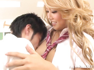 A gorgeous young blonde schoolgirl Arisa Takimoto seduces another student in the classroom.