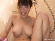 Juicy Japanese amateur milf with big tits and trimmed pussy Momoi Sakura gets hot in a bathroom and begins to pose in front of her lover's amateur camera.