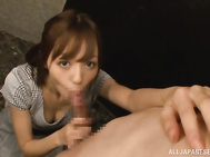 Lip smacking Asian cutie Aino Kishi on her knees making her man happy with her impressive cock sucking skills.