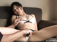 She spreads them wide and exposes her juicy pussy, and her lover drills it with a dildo toy.
