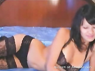 Sexy Asian webcam chick spreading her legs on cam.