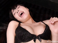 Stunning Asian babe Kana Yume is looking tempting to the camera, she reveals her big boobs, which get played with by using a makeup brush.
