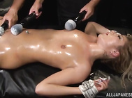 She gets her sexy body oiled from head to foot, and then the guy take some sex toys and gives her some pussy stimulation!.