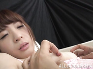 She relaxes on a leather sofa with her legs spread apart, and her experienced sex partner gives her nice pussy a perfect and deep fingering.